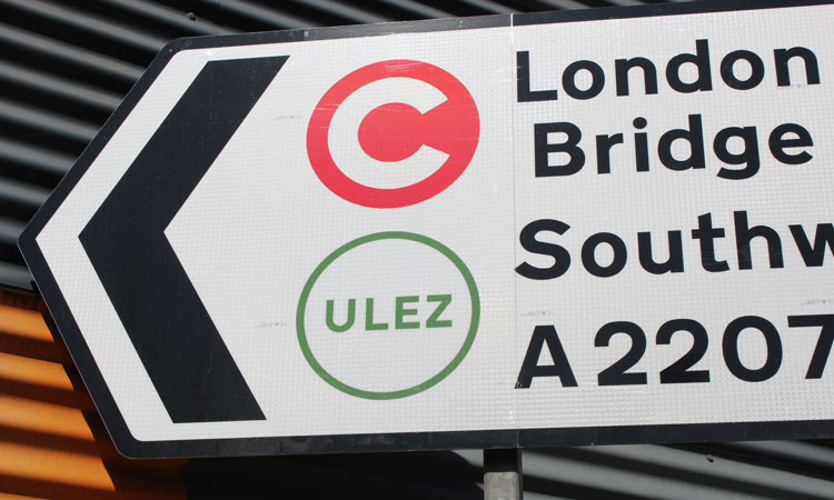 Congestion charge and ULEZ-symbols on London road sign